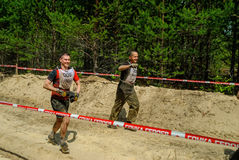 Sportsmen run between stages in extrim race.Tyumen Stock Photography