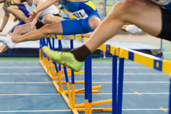 Sportsmen running hurdles sprint race Royalty Free Stock Image
