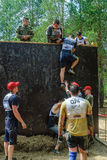 Sportsmen storm wall in extrim race. Tyumen Royalty Free Stock Photo