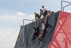 Sportsmen storms big wall in extrim race. Tyumen Stock Photo