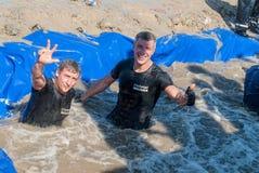 Sportsmen swim in extrim race. Steel Character Stock Photo