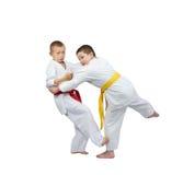 Sportsmen are training slicing down under leg. Sportsmen are training slicing down under Stock Photography