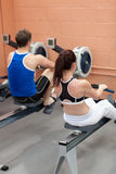 Sportsmen using a rower Royalty Free Stock Image
