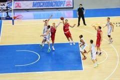 Sportsmen from Zalgiris and CSKA Moscow teams play basketball. MOSCOW - SEP 29: Sportsmen from Zalgiris (Lithuania, in white) and CSKA Moscow (Russia, in red) Royalty Free Stock Image