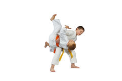 Sportsmens in judogi are doing high throws Royalty Free Stock Photos