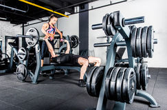 Sportspeople training in gym Stock Photos