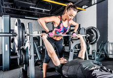 Sportspeople training in gym Stock Photography
