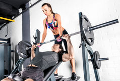 Sportspeople training in gym Royalty Free Stock Photos