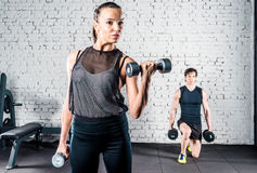 Sportspeople training in gym Royalty Free Stock Image