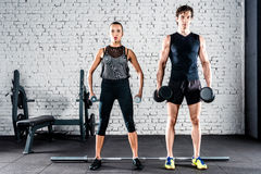 Sportspeople training in gym Royalty Free Stock Photo