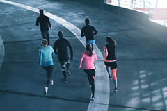Sportspeople training on race track Royalty Free Stock Images