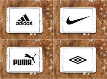Sportswear companies brands adidas , nike , puma , umbro. Logos and brands of worldwide sportswear companies adidas , nike , puma , umbro  on white tablet on Stock Image