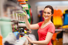 Sportswear shop assistant Royalty Free Stock Image