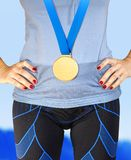 Part of winner with gold medal stock images