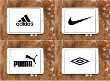 Sportswearföretag adidas, nike, kuguar, umbro stock illustrationer