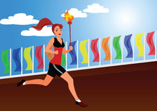 The sportswoman. Bears the Olympic fire along flags Stock Photography