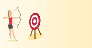 Sportswoman aiming with a bow and arrow at target. Young caucasian sportswoman aiming with a bow and arrow at the target. Concentrated sportswoman shooting an Stock Photo