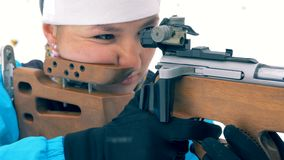 Sportswoman is aiming from a firearm. 4K stock video