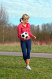 Sportswoman with a Ball Royalty Free Stock Image