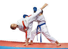 Sportswoman is beating high kick leg to the head an athlete. Sportswoman is beating kick leg to the head an athlete Stock Photo