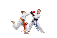 Sportswoman beats the boy punch in jump Royalty Free Stock Photo