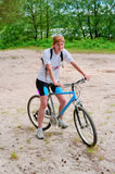 The sportswoman on a bicycle Royalty Free Stock Photos