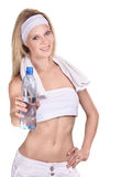 Sportswoman with a bottle of mineral water Royalty Free Stock Photography