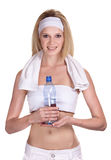 Sportswoman with a bottle of mineral water Stock Photography