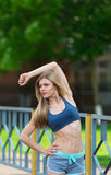 The sportswoman carries out exercises on an extension. royalty free stock photos