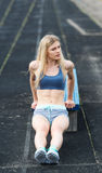 The sportswoman carries out exercises on an extension. stock image