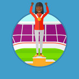 Sportswoman celebrating on the winners podium. An african sportswoman celebrating on the winners podium. Woman with gold medal and hands raised standing on the Royalty Free Stock Image