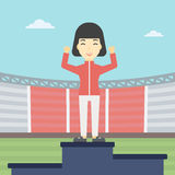 Sportswoman celebrating on the winners podium. An asian young sportswoman celebrating on the winners podium. Sportswoman standing on the first place on the Royalty Free Stock Photography