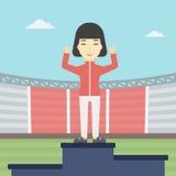 Sportswoman celebrating on the winners podium. Royalty Free Stock Photography