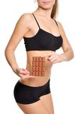 Sportswoman with chocolate. The problem and the temptation while. The girl wants chocolate. Harmful, sweet and tasty food. Sports and chocolate do not mix. If Stock Images