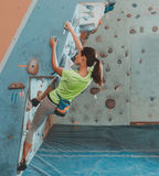Sportswoman climbing indoor Royalty Free Stock Images