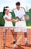 Sportswoman with coach. Practicing tennis Royalty Free Stock Photos