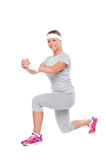 Sportswoman doing exercises Royalty Free Stock Photos