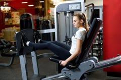 Sportswoman doing horizontal hush ups on a training royalty free stock photography