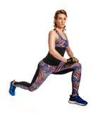Sportswoman doing lunge Royalty Free Stock Photos