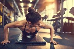 Sportswoman doing pushup exercise royalty free stock images