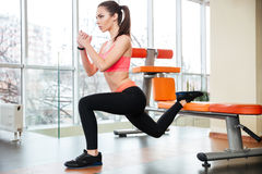 Sportswoman doing squats using bench in gym Royalty Free Stock Photography