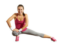 Sportswoman doing stretching exersices Stock Photography