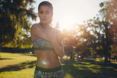 Sportswoman doing warmup exercise at the park Stock Photography