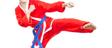 Sportswoman dressed as Santa Claus beats blow leg Stock Images