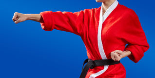 Sportswoman dressed as Santa Claus hits a punch hand Royalty Free Stock Images