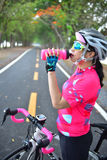 Sportswoman drinking water Stock Photo