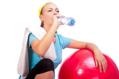 Sportswoman drinking water after training Royalty Free Stock Photography