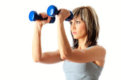 Sportswoman with dumbbells Stock Image
