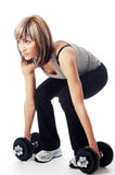 Sportswoman with dumbbells Stock Photography