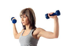 Sportswoman with dumbbells Stock Images